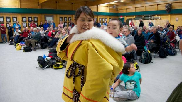 A performer wearing her traditional amauti, or woman's coat, in Cambridge Bay, Nunavut