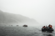 Expedition ship passengers off Monumental Island